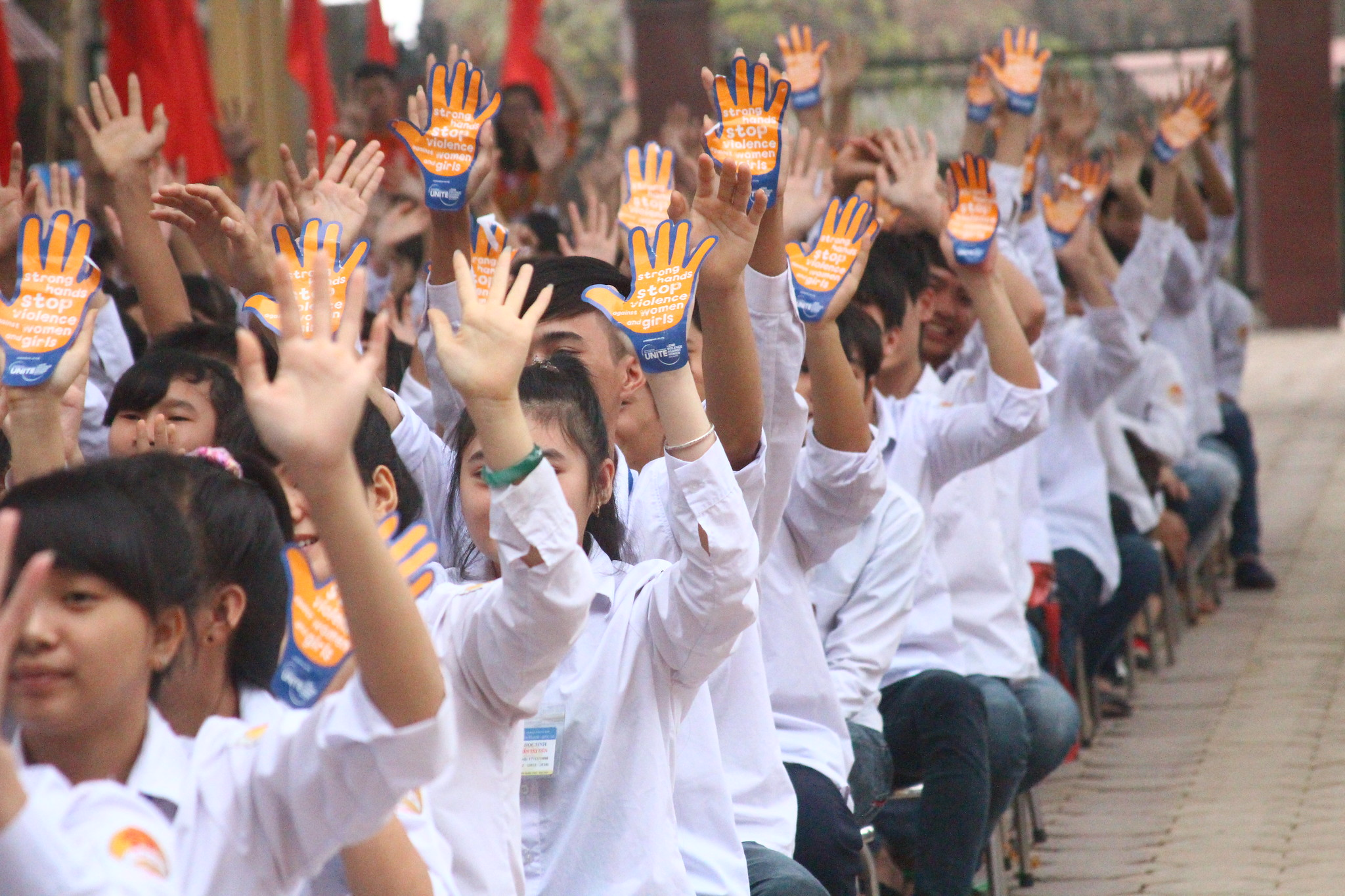 Vietnamese students commemorate the International Day on Elimination of Violence Against Women. Photo: UN Women/Thao Hoang