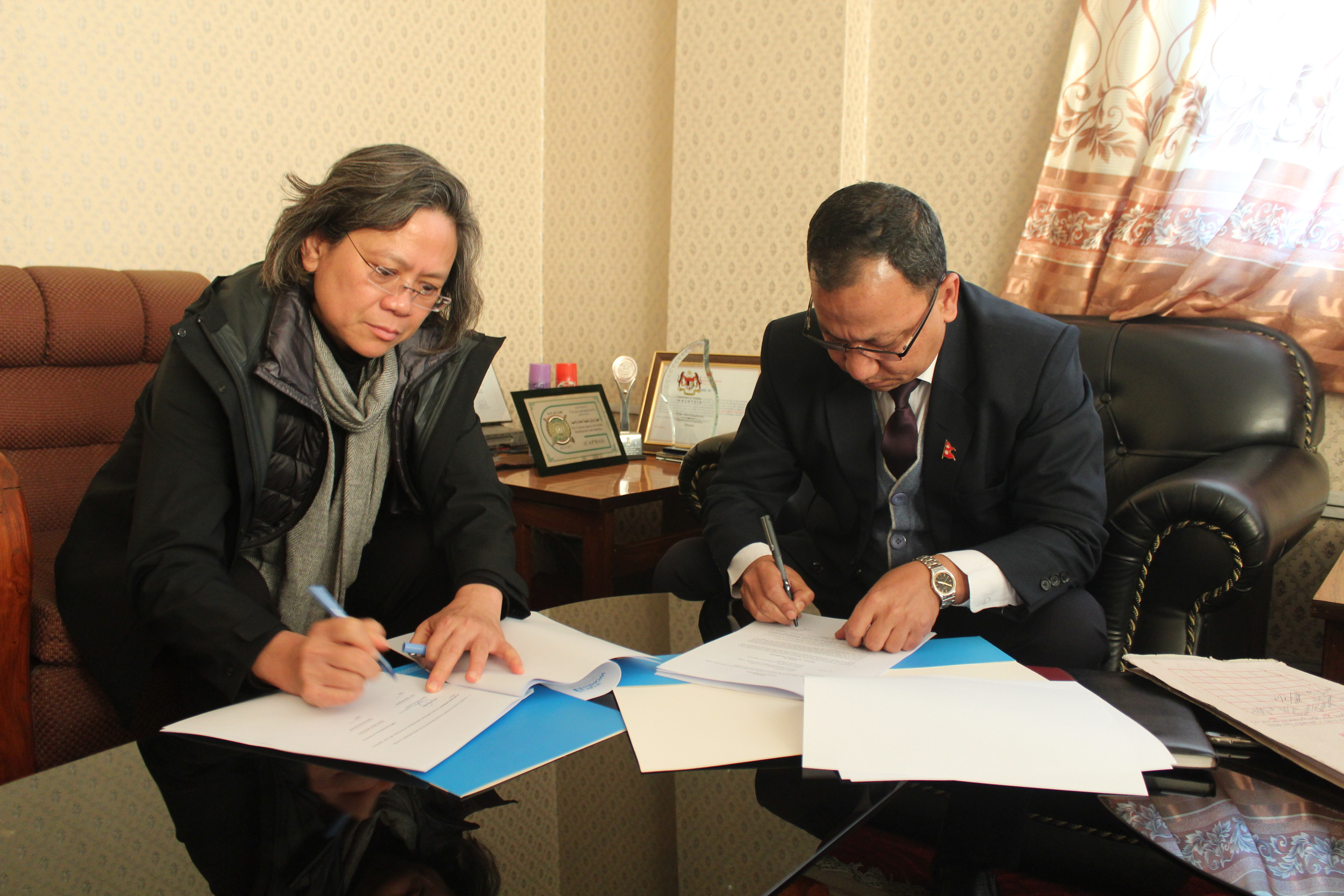 Signing of the MOU between UN Women Nepal and Central Bureau of Statistics. Photo: UN Women/Anam Abbas