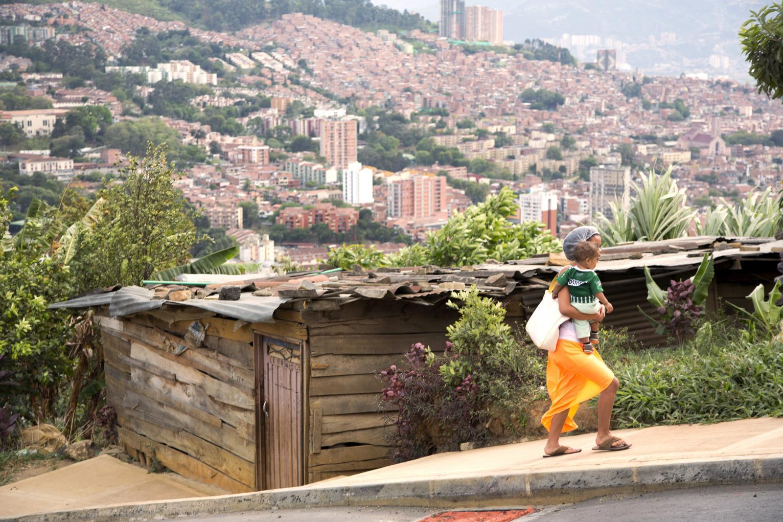 People are crowding into cities at record rates; many end up in poorer neighbourhoods with limited services and infrastructure. Electricity may be sporadic and water quality poor. Easing disparities requires specific actions to reach women, including investment in the public transport systems that many depend on. In this neighbourhood in Medellín, Colombia, most residents come from the countryside, having been displaced by conflict. Some services, like a cable car, have